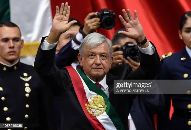 TOPSHOT Mexico's new President Andres Manuel Lopez Obrador waves after being swornin at the Congress of the Union in Mexico City on December 1 2018...