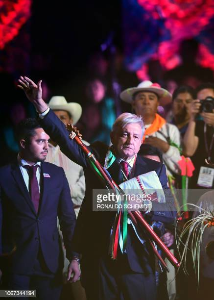 Mexico's new President Andres Manuel Lopez Obrador waves during a ceremony in which he received a ceremonial staff from indigenous people, at the...