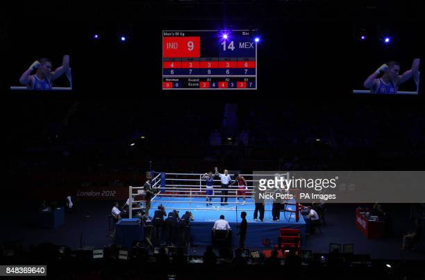 Mexico's Oscar Fierro Valdez celebrates as the referee lifts his arm in victory over India's Shiva Thapa at the ExCel Arena London