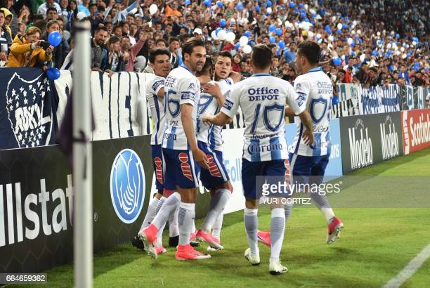 Mexico's Pachuca forward Franco Jara celebrates with teammates after scoring a goal against US's FC Dallas Hernan Grana during their CONCACAF...