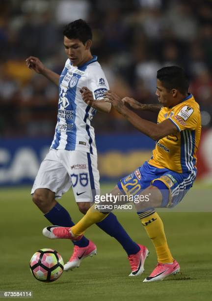 Mexico's Pachuca Hirving Lozano vies for the ball with Mexico´s Tigres Javier Aquino during their CONCACAF Champions League Final match at the...
