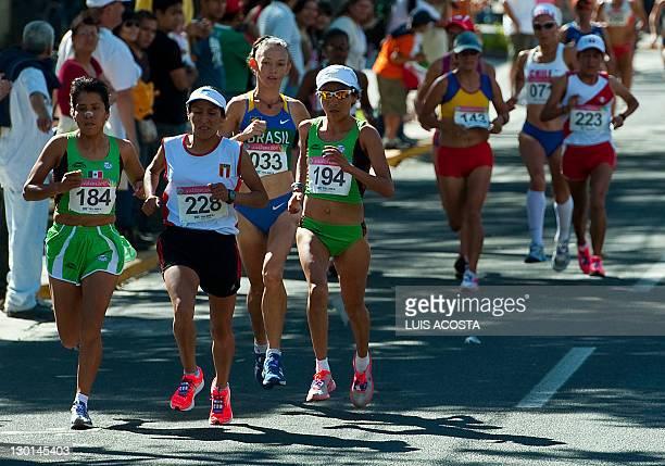 Mexico's Paula Apolonio and Madai Perez Peru's Gladys Tejada and Brazil's Adriana Da Silva compete at the Women's Marathon during the XVI Pan...
