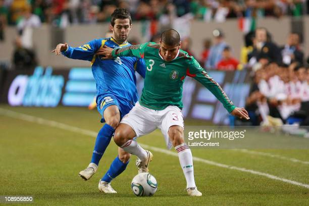 Mexico's player Carlos Salcido struggles for the ball with Miralem Pjanic of Bosnia during a friendly match between Mexico National Team and Bosnia...
