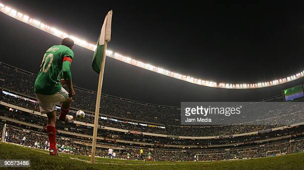 Mexico's player Cuauhtemoc Blanco kicks the ball from the corner during the FIFA 2010 World Cup Qualifying match against Honduras at the Azteca...