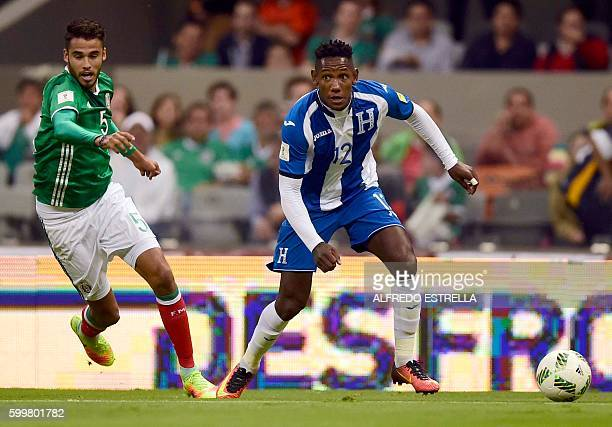 Mexico´s player Diego Reyes vies for the ball with Honduras' Romell Quioto during their Russia 2018 FIFA World Cup qualifier football match at the...