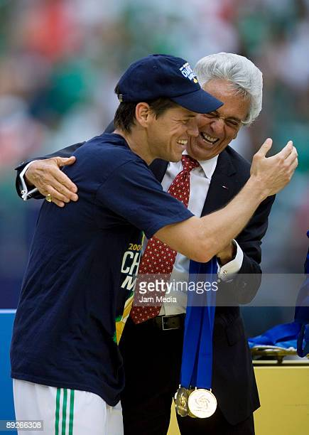 Mexico's player Guillermo Franco and Femexfut President Justino Compean celebrate the Gold Cup title after defeating USA on a score of 5-0, on July...