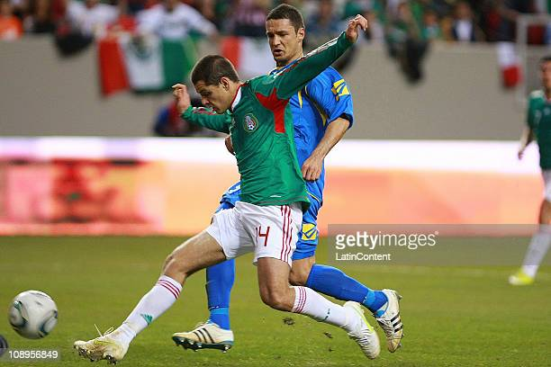 Mexico's player Javier Hernandez struggles for the ball with Haris Medunjanin of Bosnia during a friendly match between Mexico National Team and...
