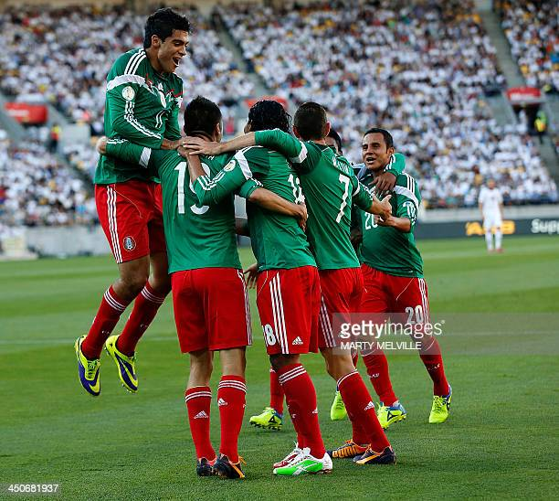 Mexico's players celebrate a goal against New Zealand during their World Cup qualifying football match at Westpac Stadium in Wellington on November...