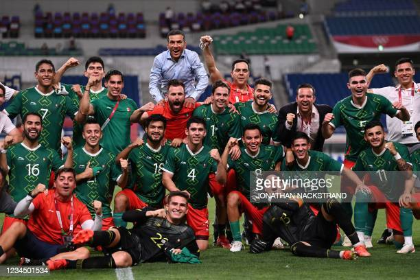 Mexico's players celebrate winning the Tokyo 2020 Olympic Games men's bronze medal football match between Mexico and Japan at Saitama Stadium in...
