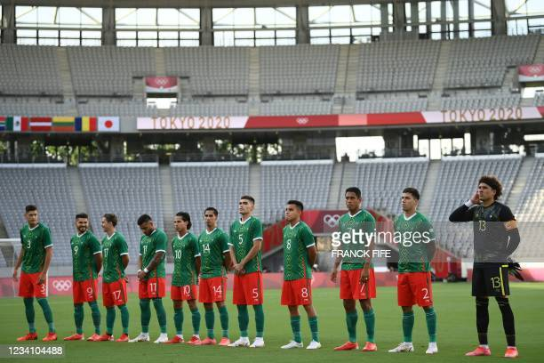 Mexico's players line up before the Tokyo 2020 Olympic Games men's group A first round football match between Mexico and France at Tokyo Stadium in...