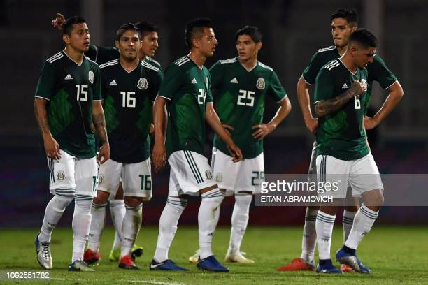Mexico's players react after losing 02 against Argentina during their friendly football match at Mario Alberto Kempes stadium in Cordoba Argentina on...