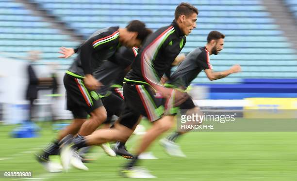 TOPSHOT Mexico's players run during a training session at the Fisht stadium in Sochi on June 20 2017 on the eve of the 2017 FIFA Confederations Cup...
