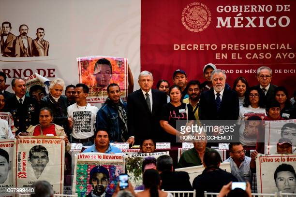 Mexico's President Andres Manuel Lopez Obrador poses with relatives of 43 missing students at the National Palace in Mexico City on December 3 2018...