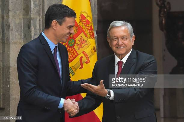 Mexico's President Andres Manuel Lopez Obrador welcomes Spain's Prime Minister Pedro Sanchez at the National Palace in Mexico City on January 30 2019...