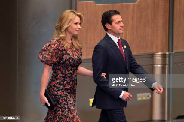 Mexico's President Enrique Pena Nieto and his wife Angelica Rivera arrive for a photo opportunity ahead of a banquet dinner during the BRICS Summit...