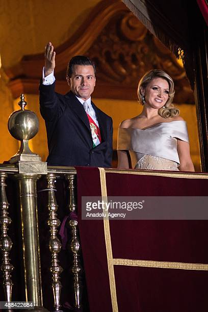 Mexico's President Enrique Pe–na Nieto and his wife first lady Angelica Rivera greet the crowd after giving the traditional 'El Grito' during the...
