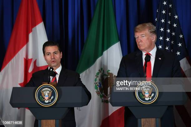 Mexico's President Enrique Pena Nieto and US President Donald Trump along with Canadian Prime Minister Justin Trudeau deliver a statement on the...