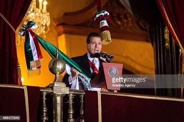 Mexico's President Enrique Pen–a Nieto delivers a speech flag after giving the traditional 'El Grito' during the anniversary of the 'Grito de...