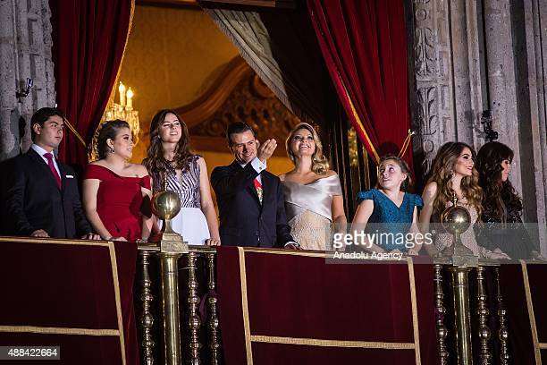 Mexico's President Enrique Pe–na Nieto first lady Angelica Rivera and their children watch the pyrotechnics after giving the traditional 'El Grito'...