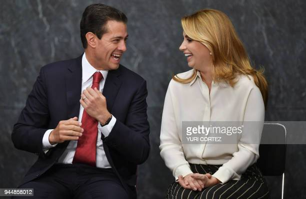 Mexico's President Enrique Pena Nieto gestures next to his wife Angelica Rivera after delivering his speech during the FIFA World Cup trophy...