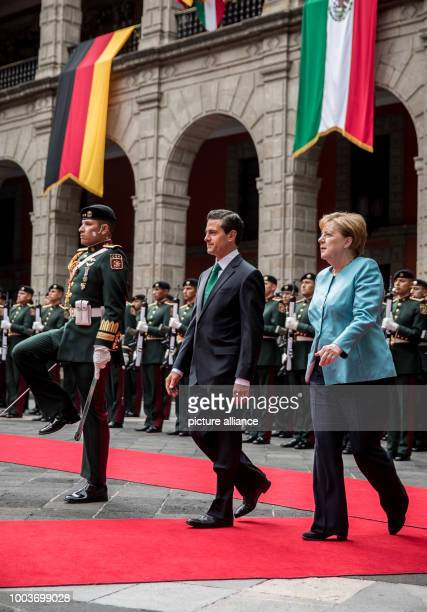 Mexico's President Enrique Pena Nieto receives German Chancellor Angela Merkel with military honours at the National Palace in Mexico City, Mexico,...