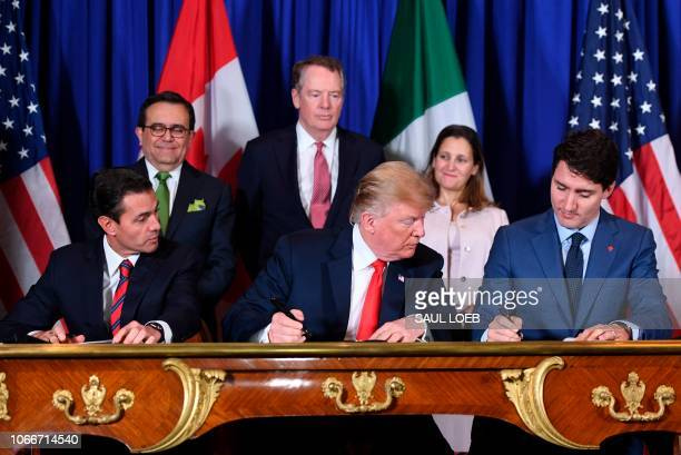 Mexico's President Enrique Pena Nieto US President Donald Trump and Canadian Prime Minister Justin Trudeau sign a new free trade agreement in Buenos...