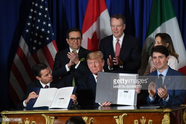 Mexico's President Enrique Pena Nieto US President Donald Trump and Canadian Prime Minister Justin Trudeau are pictured after signing a new free...