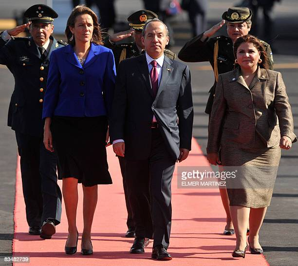 Mexico's President Felipe Calderon and his wife Margarita Zavala review a guard of honor accompanied by El Salvador's Foreign Minister Marisol...