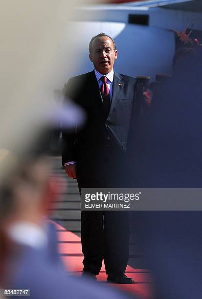 Mexico's President Felipe Calderon sings Mexico's national anthem upon arrival to El Salvador's airport in Comalapa some 45 kms south of San Salvador...
