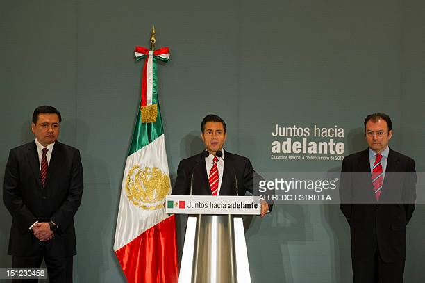 Mexico's Presidentelect Enrique Pena Nieto accompanied by his two collaborators Miguel Angel Osorio Chong and Luis Videgaray offers a press...