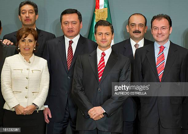 Mexico's Presidentelect Enrique Pena Nieto poses with his transition team with members of the current government and the future one towards his...
