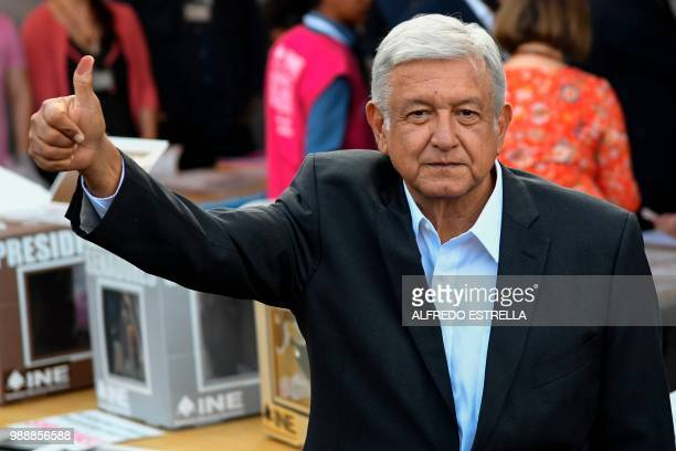 Mexico's presidential candidate Andres Manuel Lopez Obrador for the 'Juntos haremos historia' party gives his thumb up after casting his vote during...