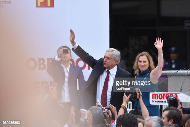 Mexico's presidential candidate Andres Manuel Lopez Obrador of MORENA party waves next to his wife Beatriz Gutierrez Muller after presenting his...
