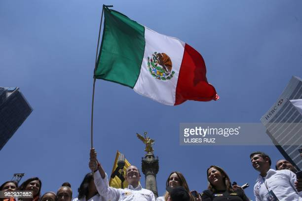 Mexico's presidential candidate Ricardo Anaya standing for the 'Mexico al Frente' coalition of the PANPRDMovimiento Ciudadano parties waves a Mexican...