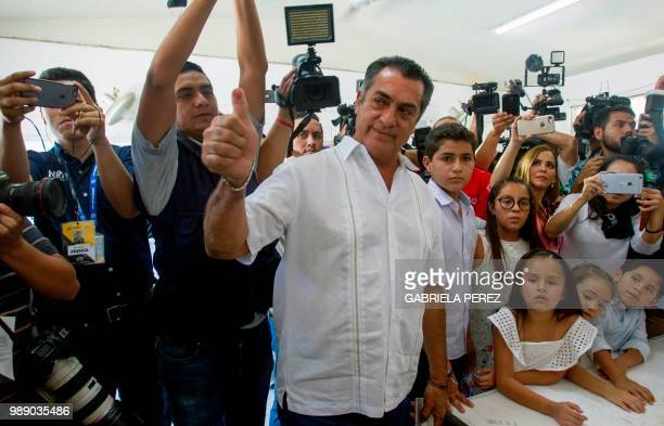 Mexico's presidential independent candidate Jaime 'El Bronco' Rodriguez Calderon gives his inked thumb up after casts his vote during general...