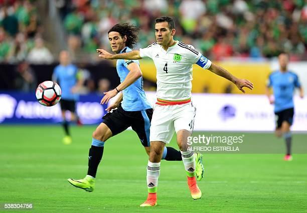 Mexico's Rafael Marquez and Uruguay's Edinson Cavani vie for the ball during their Copa America Centenario football tournament match in Glendale...
