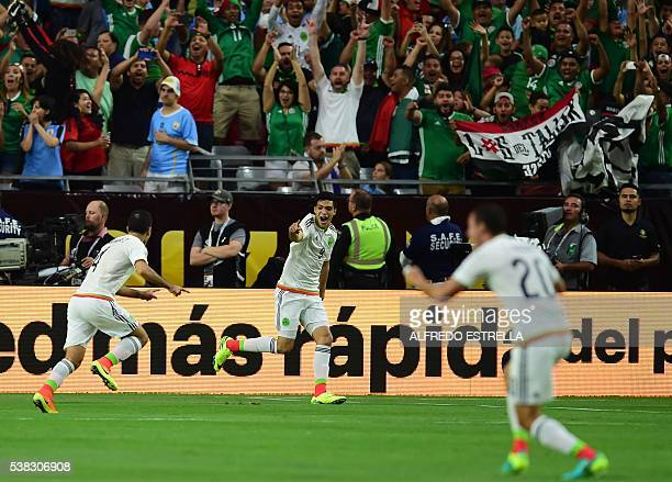 Mexico's Rafael Marquez celebrates with teammates after scoring against Uruguay during their Copa America Centenario football tournament match in...