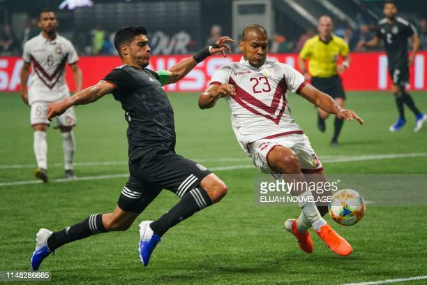 Mexico's Raul Jimenez battles for control of the ball with Venezuela's Salomon Rondon during the international friendly match between Venezuela and...