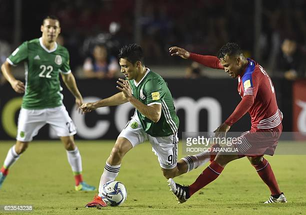 Mexico's Raul Jimenez is marked by Panama's Amilcar Henriquez during their 2018 FIFA World Cup qualifier football match in Panama City on November 15...
