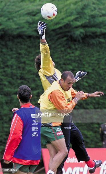 Mexico's reserve goalkeeper Adrian Martinez fights for the ball with starting goalkeeper Oscar Perez during a team practice at Carmel Club in Bogota...