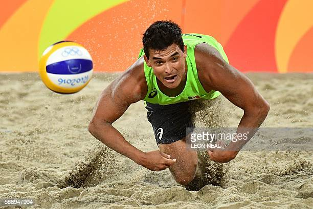 Mexico's Rodolfo Lombardo Ontiveros Gomez dives for the ball during the men's beach volleyball round of 16 match between Mexico and the Netherlands...