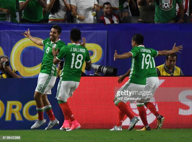 Mexico's Rodolfo Pizarro celebrates with teammates after scoring against Honduras during their 2017 CONCACAF Gold Cup quarterfinal match at the...
