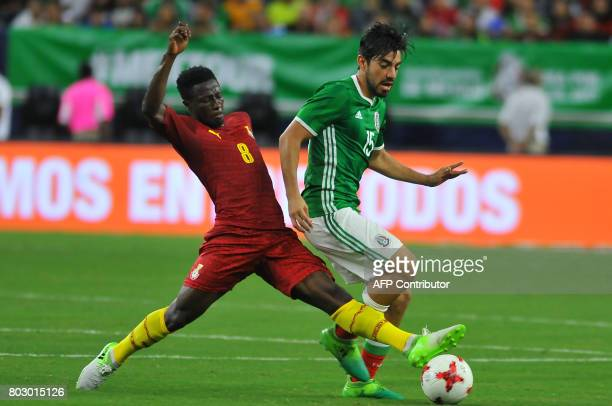 Mexico's Rodolfo Pizarro vies for the ball with Ghana's Ebenezer Ofori during the friendly match between Mexico and Ghana at NRG stadium on June 28...