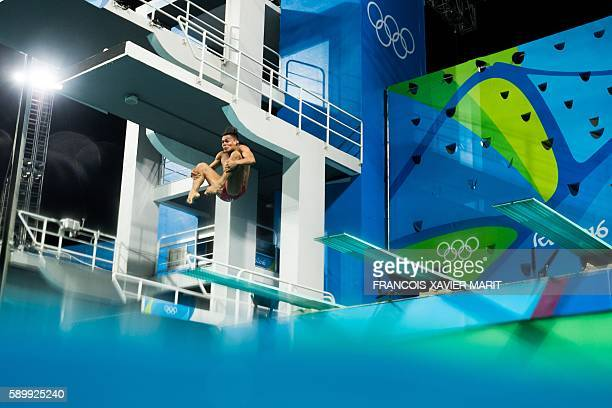 TOPSHOT Mexico's Rodrigo Diego Lopez competes in the Men's 3m Springboard Preliminary during the diving event at the Rio 2016 Olympic Games at the...