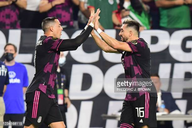 Mexico's Rogelio Funes Mori celebrates after scoring with teammate Hector Herrera during the Concacaf Gold Cup quarter final footbal match between...