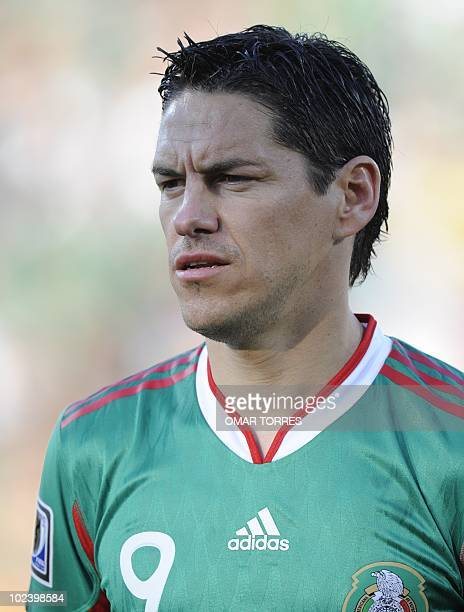 Mexico's striker Guillermo Franco sings the national anthem during their Group A first round 2010 World Cup football match on June 22 2010 at Royal...