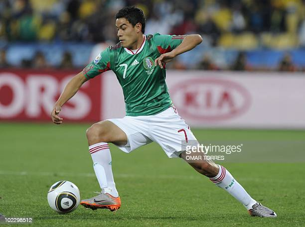 Mexico's striker Pablo Barrera drives the ball during their Group A first round 2010 World Cup football match against Uruguay on June 22 2010 at...