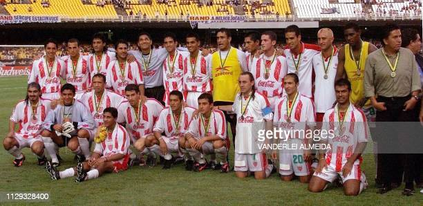 Mexico's team Necaxa poses with the World Club Championship third place medal 14 January after beating Real Madrid at Maracana Stadium in Rio de...