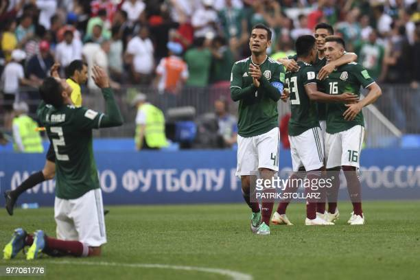 Mexico's team players celebrate after winning at the end of the Russia 2018 World Cup Group F football match between Germany and Mexico at the...