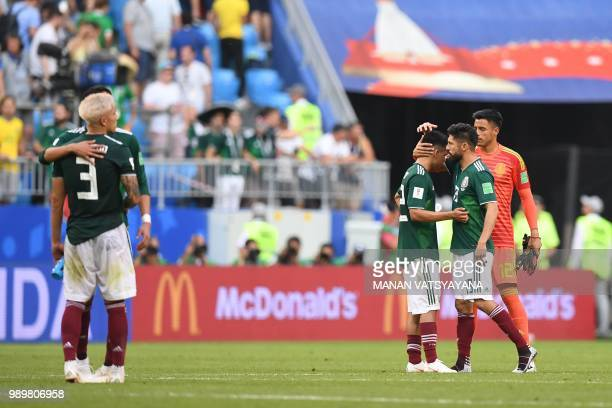 Mexico's team players react at the end of the Russia 2018 World Cup round of 16 football match between Brazil and Mexico at the Samara Arena in...